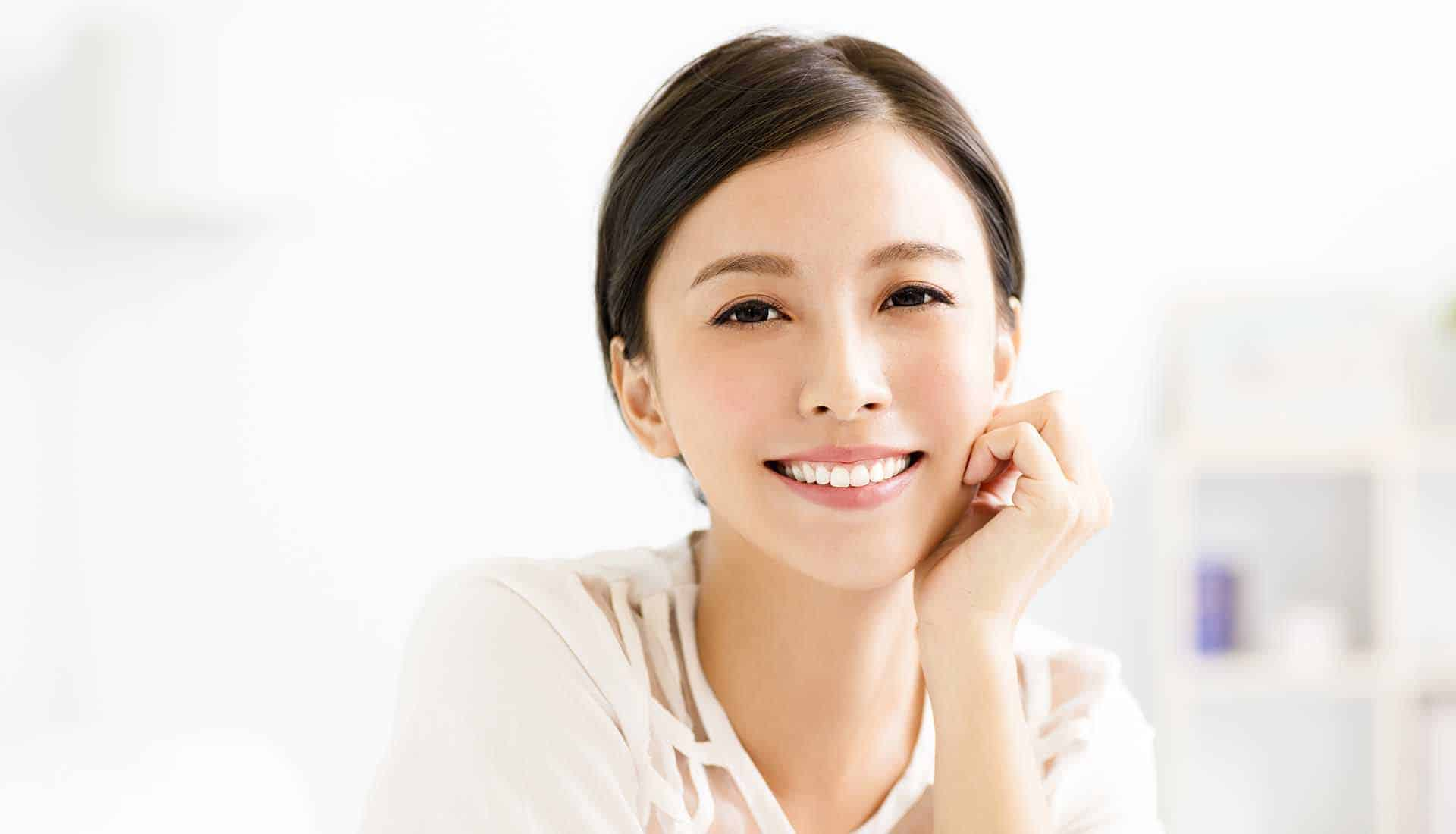 closeup smiling young asian woman face in living room