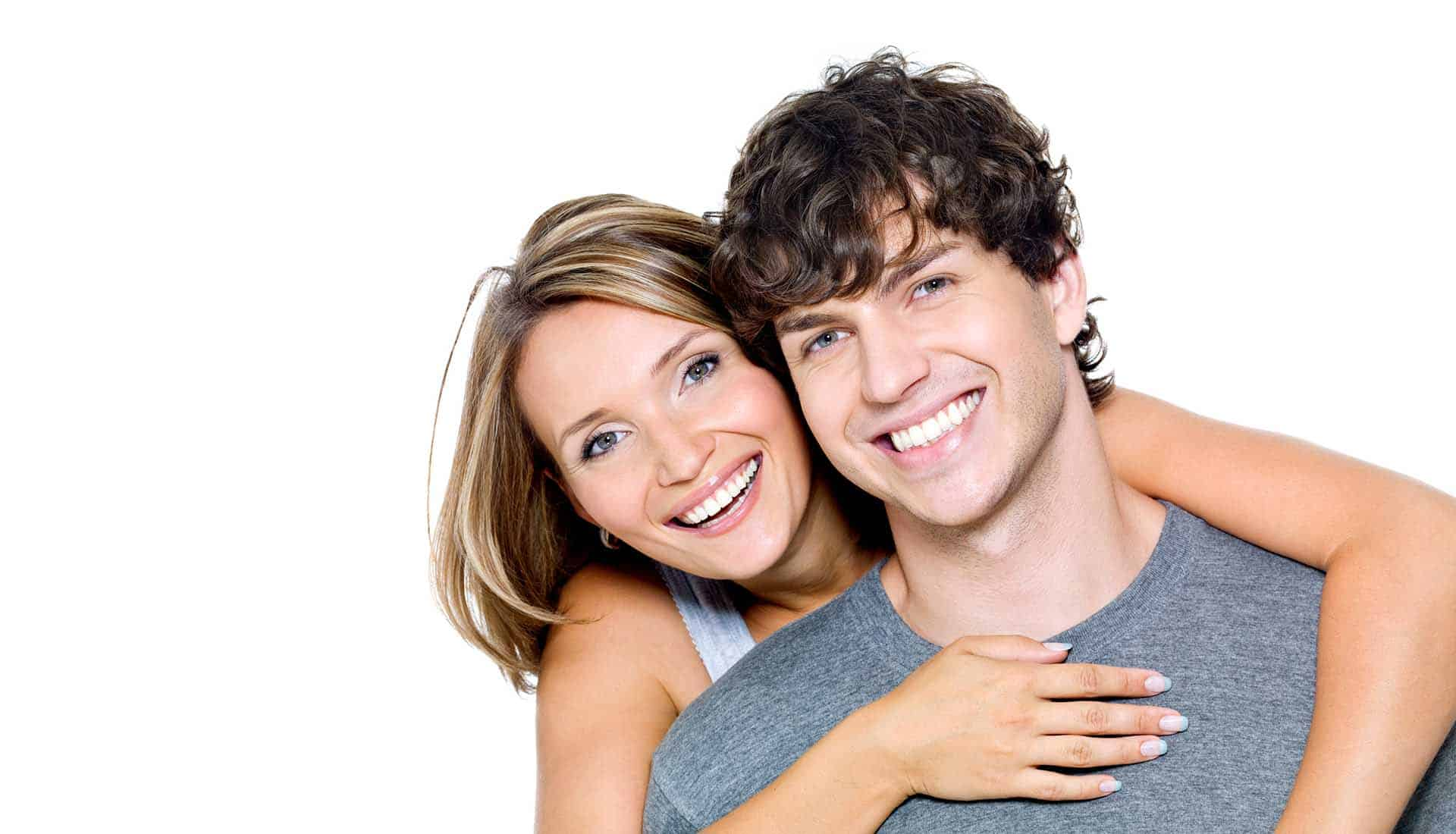 Portrait of a beautiful young happy smiling couple on a white background.