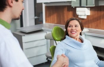 Woman in Dental Chair Visiting a Prosthodontist Atlanta GA